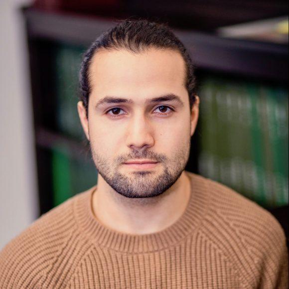 Jose Quintero headshot - a Latino man with dark hair and beard
